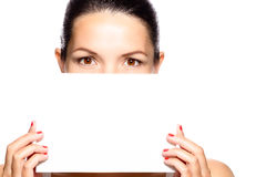 Woman with beautiful eyes holding a sign Stock Image