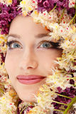 Woman beautiful face with chestnut flower frame Stock Photo