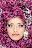 Woman beautiful face with flower lilac border Royalty Free Stock Photo