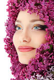 Woman beautiful face with flower lilac border Royalty Free Stock Images