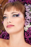 Woman beautiful face with flower lilac frame Stock Photography