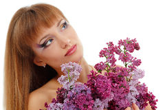 Woman beautiful face with flower lilac isolated Royalty Free Stock Photos
