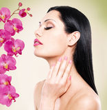 Woman with beautiful face and fresh flowers Stock Photos