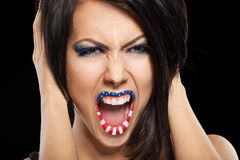 Woman beautiful face with perfect makeup. On black backround. on the lips and eyes painted an usa flag Stock Images