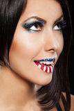 Woman beautiful face with perfect makeup. On the lips and eyes painted an American flag Royalty Free Stock Photography