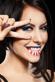 Woman beautiful face with perfect makeup. On the lips and eyes painted an American flag Royalty Free Stock Photos