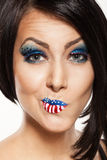 Woman beautiful face with perfect makeup. On the lips and eyes painted an American flag Stock Photos