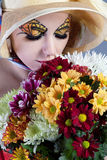 Woman with beautiful flowers Stock Image