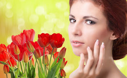Woman with Beautiful garden fresh red tulips Royalty Free Stock Photography