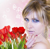 Woman with Beautiful garden fresh red tulips Royalty Free Stock Photos