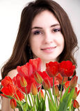 Woman with Beautiful garden fresh red tulips Royalty Free Stock Images