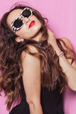 Woman with beautiful hair wearing sunglasses and posing Royalty Free Stock Photography
