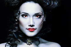 Woman beautiful halloween vampire baroque aristocrat. Over black background Royalty Free Stock Photography
