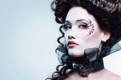 Woman beautiful halloween vampire baroque aristocrat. Over black background stock photo