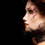 Woman beautiful halloween vampire baroque aristocrat. Over black background Royalty Free Stock Image
