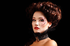 Woman beautiful halloween vampire baroque aristocrat. Over black background Royalty Free Stock Images