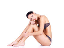 Woman with beautiful legs in bikini royalty free stock image