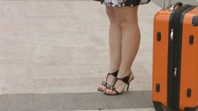 Woman with beautiful legs in high heel shoes waiting for train, bus at station. Stock footage stock footage