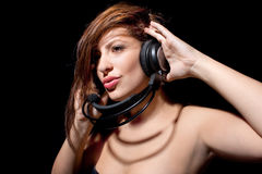 Woman with beautiful lips listening headphones Royalty Free Stock Photos
