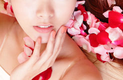 Woman beautiful lips with pink and red roses Stock Photo