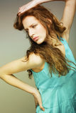Woman with beautiful long blond curly  hairs. Sensual pretty woman with beautiful long blond curly  hairs Stock Photo