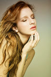 Woman with beautiful long blond curly  hairs. Sensual pretty woman with beautiful long blond curly  hairs Stock Image