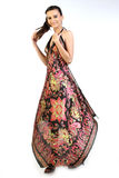 Woman with beautiful long gown. Woman with multicolored long dress Royalty Free Stock Photo