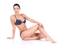 Woman with beautiful long slim legs Stock Images