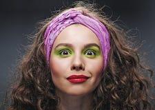 Woman with beautiful makeup and long curly hair Stock Photos