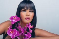 Woman with beautiful makeup and pink orchids Stock Photos