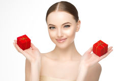 Woman Beautiful model with red boxes with gold ribbons with gift Stock Photos