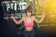 Woman beautiful muscular fit woman exercising building muscles Royalty Free Stock Photography