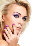 Woman with beautiful nails and eye makeup Stock Images
