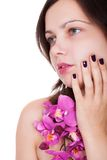 Woman with beautiful nails holding orchids Stock Image