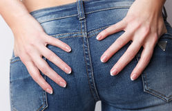 Woman with beautiful nails touching her bottom Stock Images