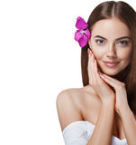 Woman beautiful portrait with flower orchid in hair isolated on white Stock Photo