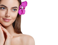 Woman beautiful portrait with flower orchid in hair isolated on white Royalty Free Stock Photos