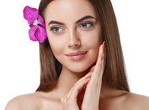 Woman beautiful portrait with flower orchid in hair isolated on white Stock Image