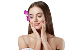 Woman beautiful portrait with flower orchid in hair isolated on white Royalty Free Stock Images