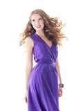 Woman beautiful portrait in purple silk dress, long hairs Royalty Free Stock Images