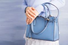 Woman with beautiful purse Stock Photo