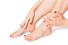 Woman with beautiful red finger and toenails Royalty Free Stock Image