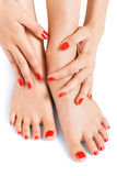 Woman with beautiful red finger and toenails Royalty Free Stock Photo