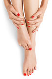 Woman with beautiful red finger and toenails Royalty Free Stock Photos