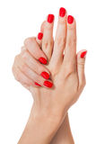 Woman with beautiful red finger and toenails Stock Photos