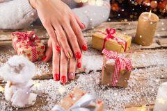 Woman with beautiful red nails on vintage wooden table royalty free stock image