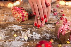 Woman with beautiful red nails on vintage wooden table stock photos