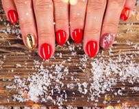 Woman with beautiful red nails on vintage wooden table stock photography
