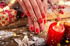 Woman with beautiful red nails on vintage wooden table stock images