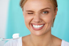 Woman With Beautiful Smile Brushing Healthy White Teeth. Healthy White Teeth. Closeup Portrait Of Beautiful Happy Smiling Woman With Fresh Perfect Smile Brushing stock photography